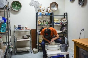 Man working in private ceramic studio